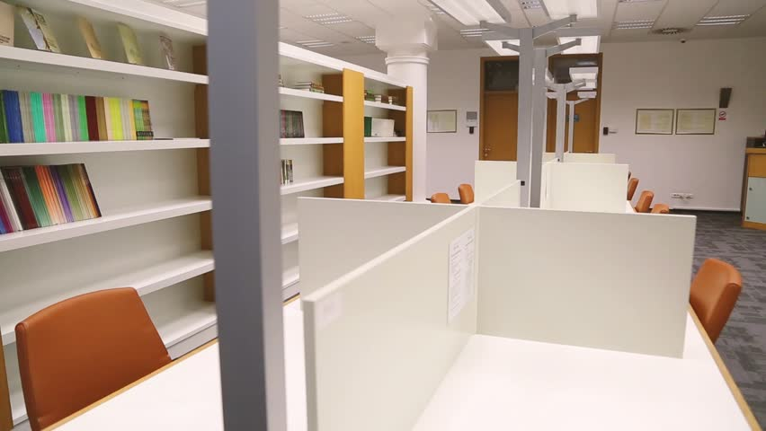 Modern library interior with bookcase and computers, space where students learning during education progress. | Shutterstock HD Video #31273834