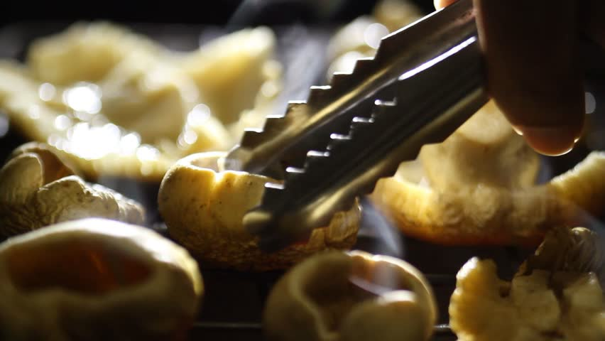 Chef grill mushroom on grille at restaurant kitchen for barbecue party | Shutterstock HD Video #31275685