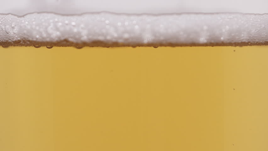 Slow motion macro lager beer pour into glass #31286332