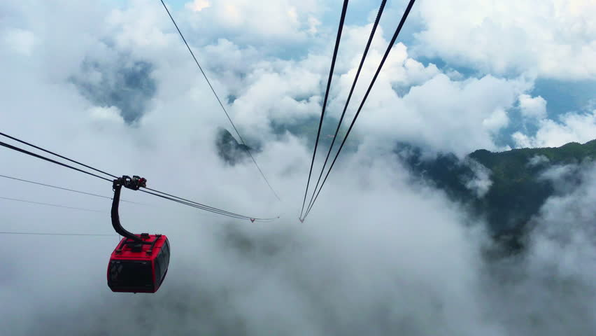Beautiful view from ropeway car moving up the mountain in Cloudy day ,Cable Car In The Clouds , Fansipan in Sapa, Vietnam | Shutterstock HD Video #31294462