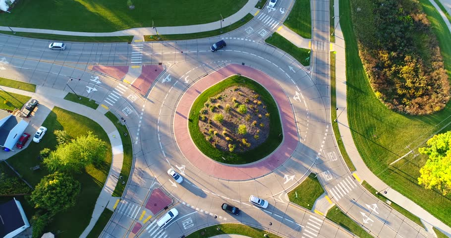 Early morning rush hour at busy city roundabout, time lapse aerial view.    Shutterstock HD Video #31297930
