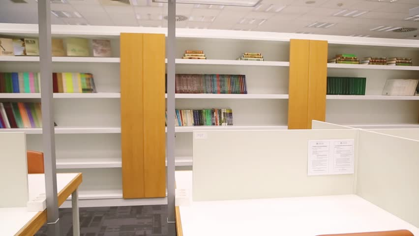 Modern library interior with bookcase and computers, space where students learning during education progress. | Shutterstock HD Video #31300813