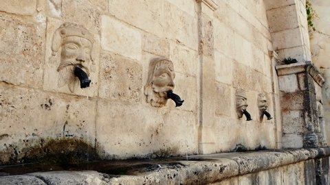 ancient fountain in an historic Italian city