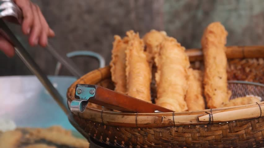 Taking Out Deep Fried Food From Oil And Into Basket - Slide Right And Left - Close Up Royalty-Free Stock Footage #31347649