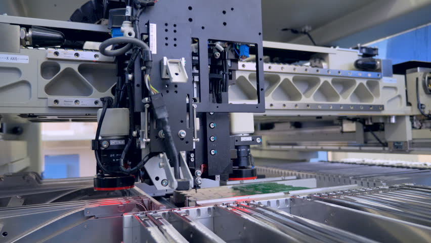 Automated Circut Board machine Produces Printed digital electronic board. 4K. Royalty-Free Stock Footage #31349728