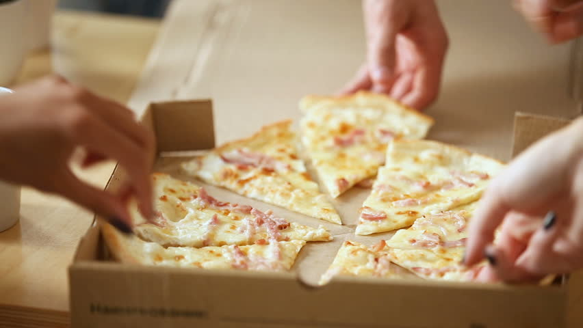 Human hands taking pieces slices of hot tasty italian pizza from open box, food delivery service at party catering concept, friends having fun enjoying eating hanging out together, close up view #31351978