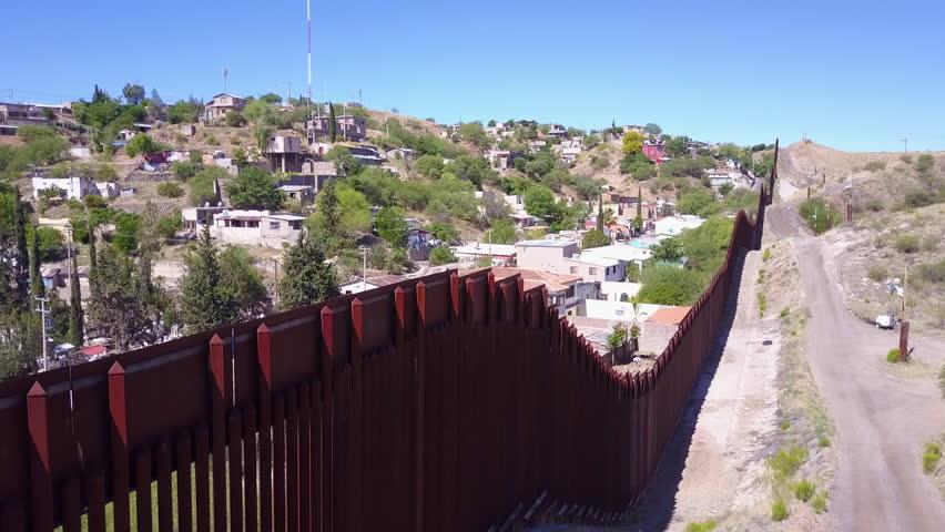 CIRCA 2010s - U.S.-Mexico border - A view along the US Mexico border at Nogales, Arizona.
