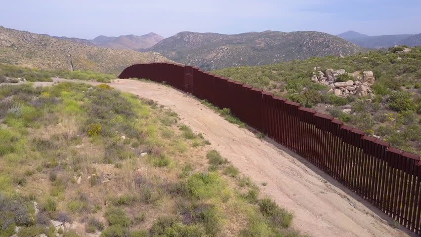 CIRCA 2010s - U.S.-Mexico border - A low aerial along the U.S Mexican border wall fence.