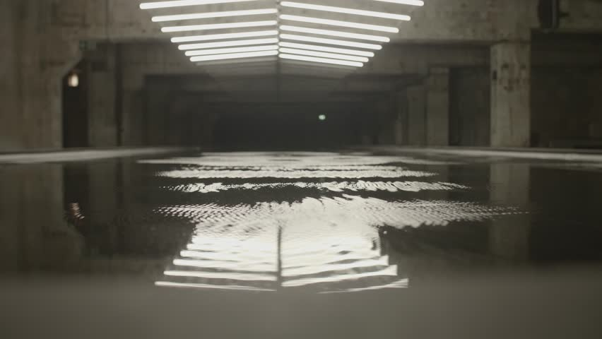 4k shot of white fluorescent lighting turn on and off and reflecting in the water or puddle in industrial building. Many neon lights blinking and flashing on the ceiling. | Shutterstock HD Video #31374811