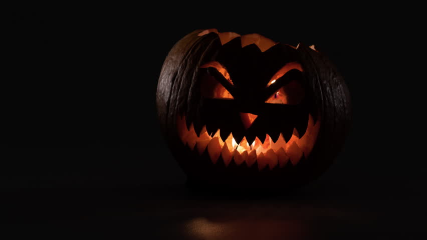 Halloween pumpkin with candles inside laughing in dark. 4k stop-motion animation. | Shutterstock HD Video #31379638