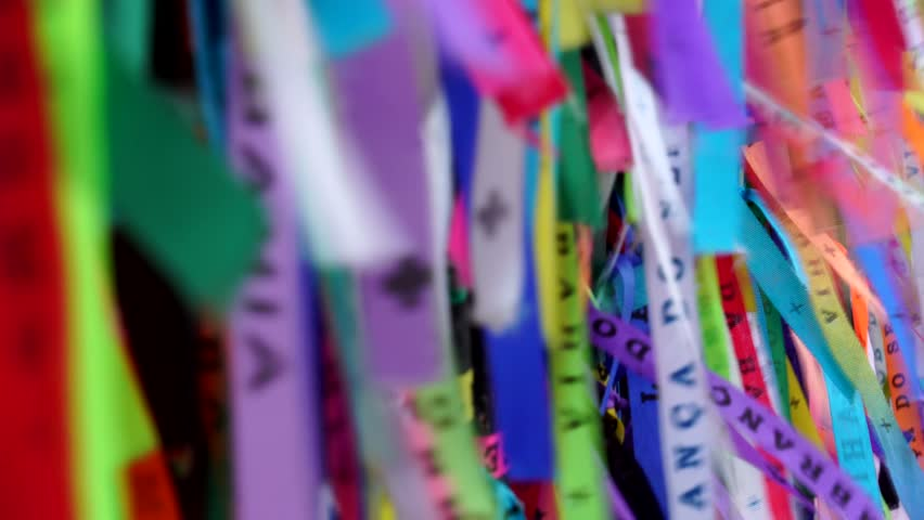 Colored ribbons tied in the railing of the Church of Our Lord of Bonfim in Salvador, Brazil | Shutterstock HD Video #31383646