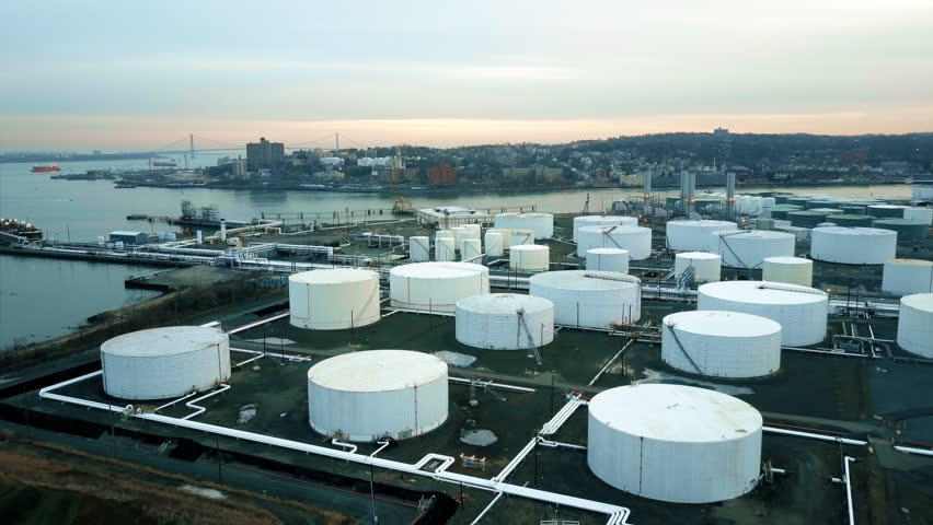 Aerial view of storage tanks at oil refinery 4K