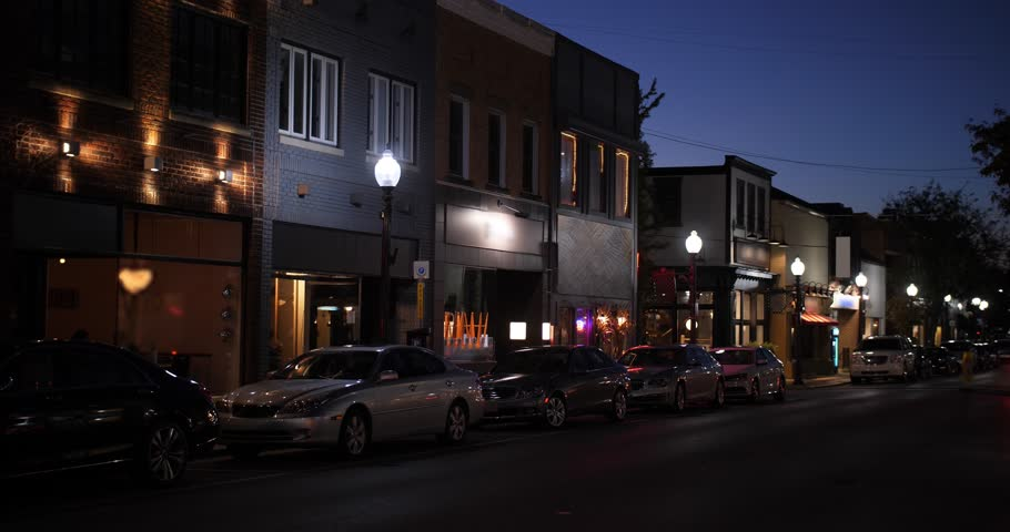 A nighttime establishing shot of businesses on a typical Main Street in America. Pittsburgh suburb. Day/Night matching available.