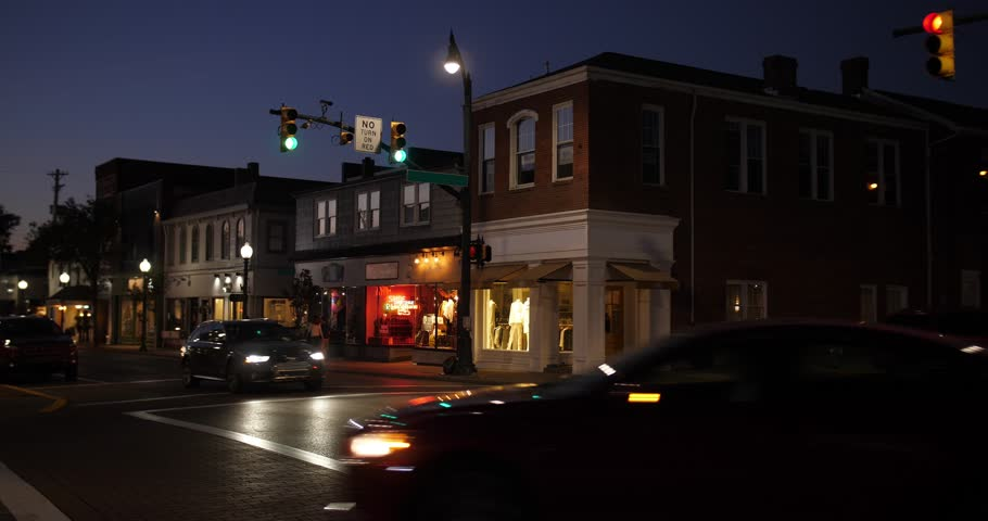 9334 A nighttime establishing shot of businesses on a typical Main Street in America. Pittsburgh suburb.Building names and addresses obscured.  Day/Night matching available. Day ID: 20833027