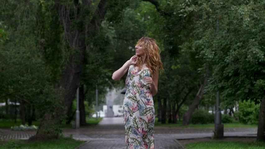 Portrait of young beautiful woman in rain. slow motion | Shutterstock HD Video #31419469