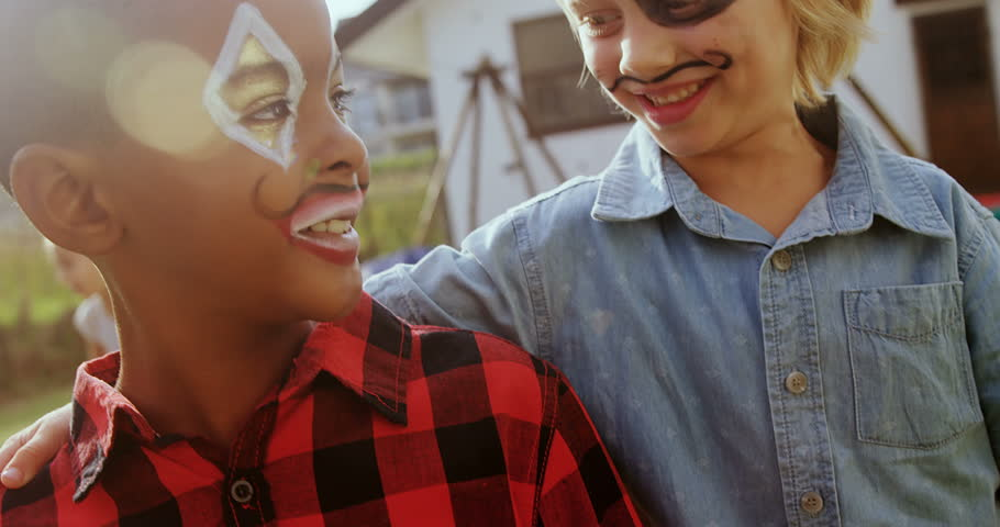 Close up happy friends with face paint 4k #31424383
