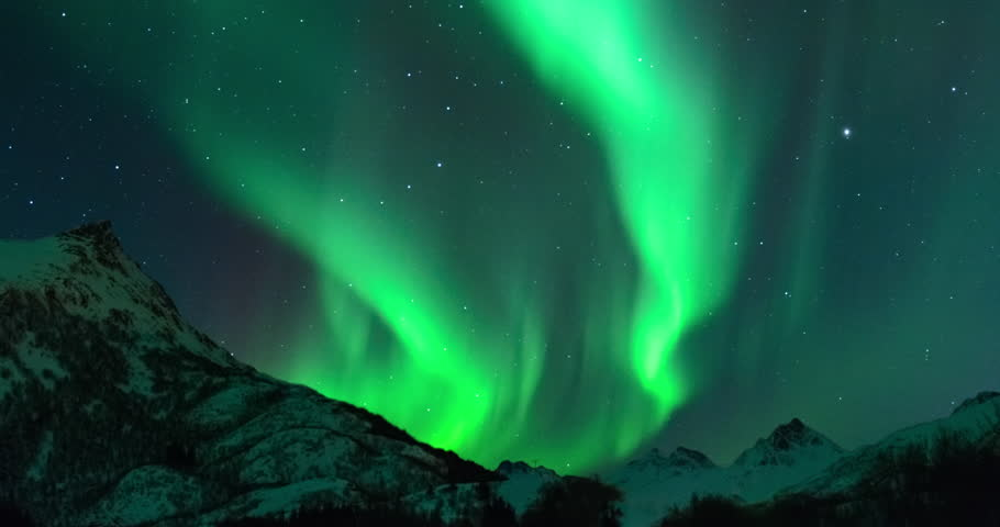 Time lapse clip of Polar Light or Northern Light (Aurora Borealis) in the night sky over the Lofoten islands in Northern Norway in winter.