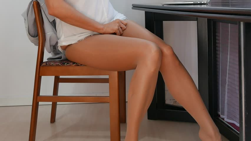 Photo of young woman with sexy legs and a suitcase