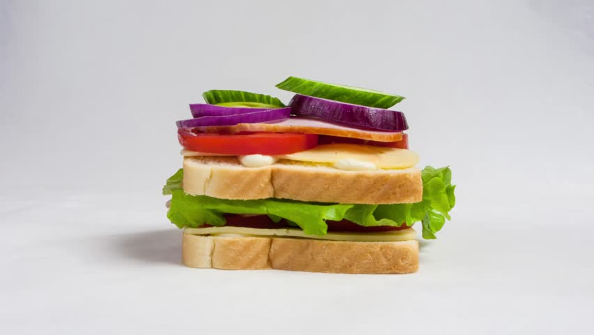 Time lapse of making a big sandwich with tomato, ham, cheese and salad. Stop motion of preparing snacks | Shutterstock HD Video #31492276