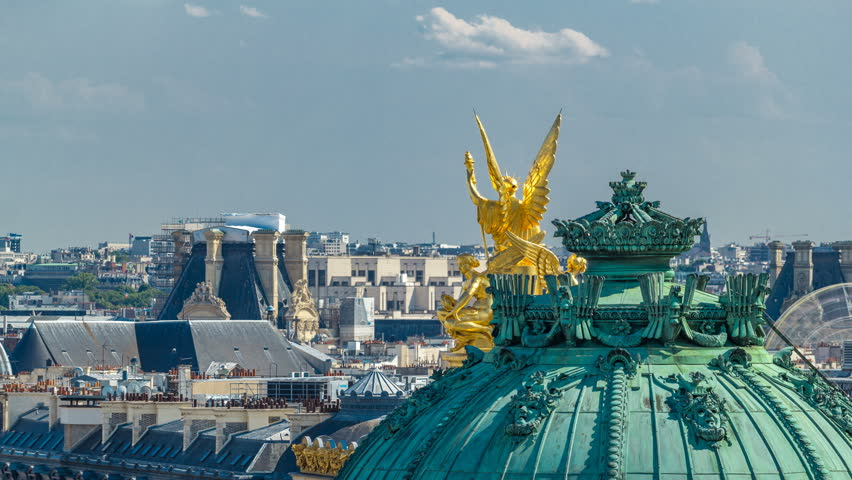 Top view of Palais or Opera Garnier The National Academy of Music timelapse in Paris, France. Aerial view from rooftop at sunny summer day. It is a 1979-seat opera house, which was built from 1861 to