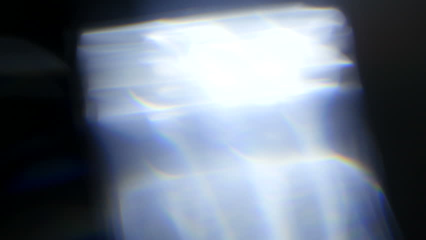 Light pulses.Beautiful light leak in Ultra High on dark background with Real lens flare.no.107 | Shutterstock HD Video #31512538