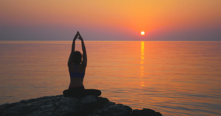 Meditating near the sea   Shutterstock HD Video #31513405