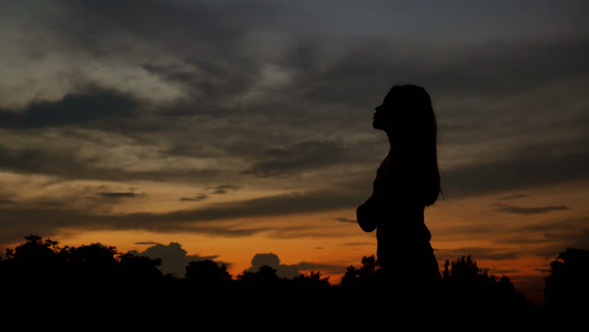 Silhouette Of Woman Looking Up Stock Footage Video 100 Royalty Free 31514152 Shutterstock