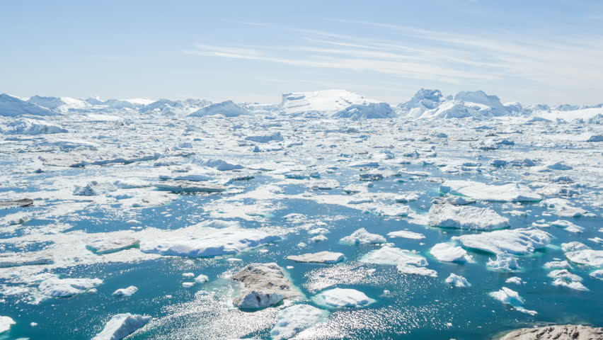 Iceberg and ice from glacier in arctic nature landscape on Greenland. Aerial video drone footage of icebergs in Ilulissat icefjord. Affected by climate change and global warming.   Shutterstock HD Video #31522969
