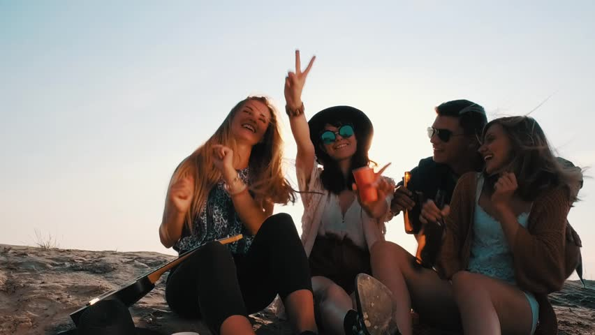 Friends having fun and enjoying beach festival, youth concept | Shutterstock HD Video #31537951