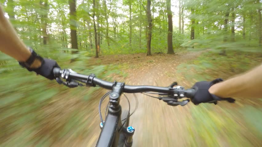 Downhill mountain biking first person point of view on bike trail in summer woods. Forest extreme speed riding, first person perspective view POV. Gimbal stabilized video 4K. | Shutterstock HD Video #31540228