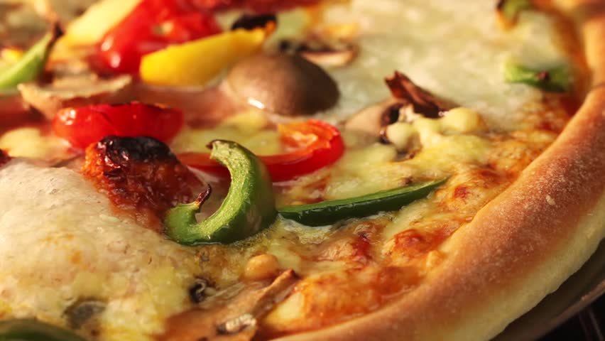 A vegetarian pizza in an oven (close-up) | Shutterstock HD Video #3154162
