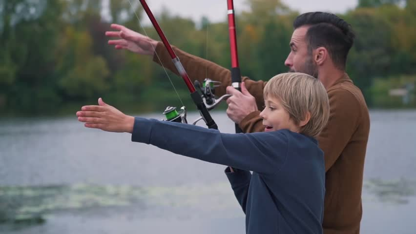 Father with son are fishing.