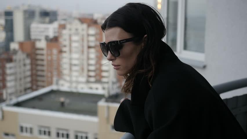 Pretty woman admiring cityscape | Shutterstock HD Video #31572586