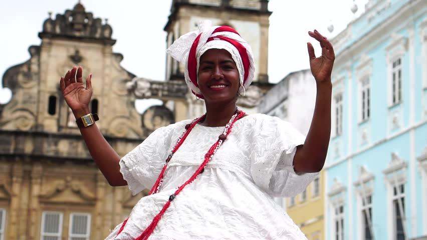Brazilian Woman (Baiana) dancing in Salvador, Bahia, Brazil