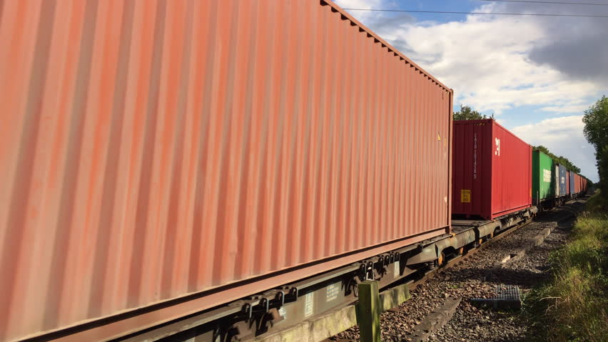 Oakham, Rutland, UK - September 14, 2017: A railway freight train of cargo shipping containers passing through the Rutland countryside in England.