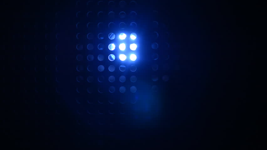 Rays of blue color from searchlight through lattice. Movement of the light of the blue lantern on a dark perforated background | Shutterstock HD Video #31576699