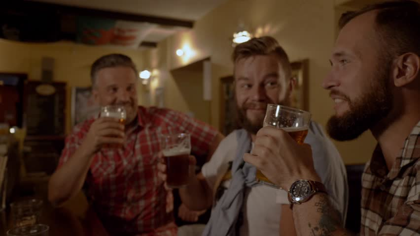 Good old friends drinking beer in a pub #31586164