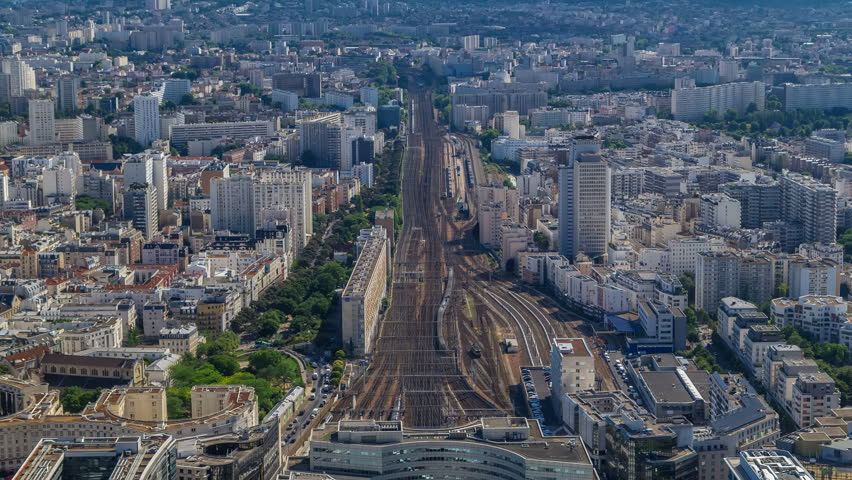 Top view of Paris skyline from above timelapse. Main landmarks of european megapolis with train station of Vaugirard-Belt. Bird-eye view from observation deck of Montparnasse tower. Paris, France   Shutterstock HD Video #31599226