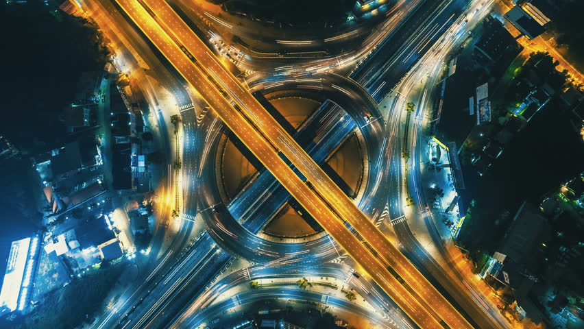 Hyperlapse timelapse of night city traffic on 4-way stop street intersection circle roundabout in bangkok, thailand. 4K UHD horizontal aerial view. | Shutterstock HD Video #31621018