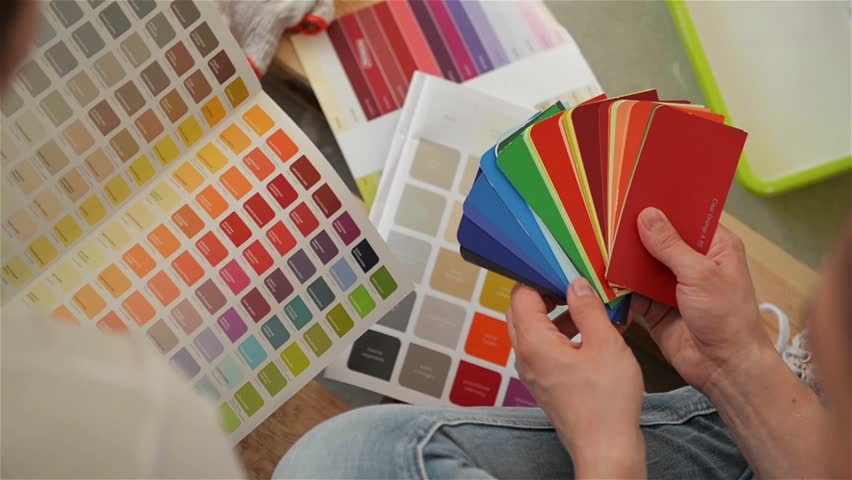 View of Palette in Female and Male Hands. Young Happy Family Choosing Colors for Their New Flat. #31622806
