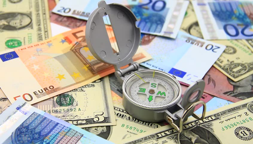 Compass on paper money; how to exit international crisis? | Shutterstock HD Video #3163552