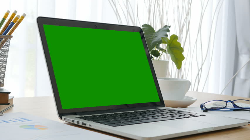 4K : A laptop computer with a key green screen set on work office table. | Shutterstock HD Video #31644238