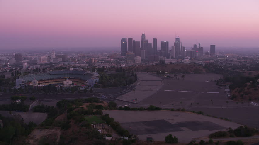 Los Angeles, California circa-2017, Flying by Dodger Stadium with downtown Los Angeles in distance. Shot with Cineflex and RED Epic-W Helium.