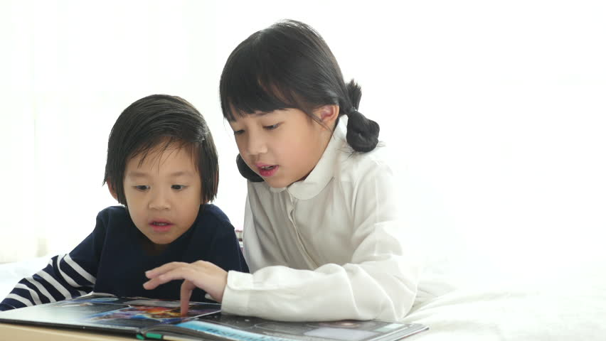 Cute Asian Children Reading a Stock Footage Video (100% Royalty-free)  31650541 | Shutterstock
