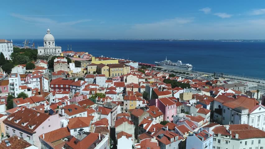 Aerial view Portugal Lisbon the Alfama is oldest district of Lisbon spreading on slope between Sao Jorge Castle and Tejo river its name comes from the Arabic Al-hamma meaning hot fountains or bath