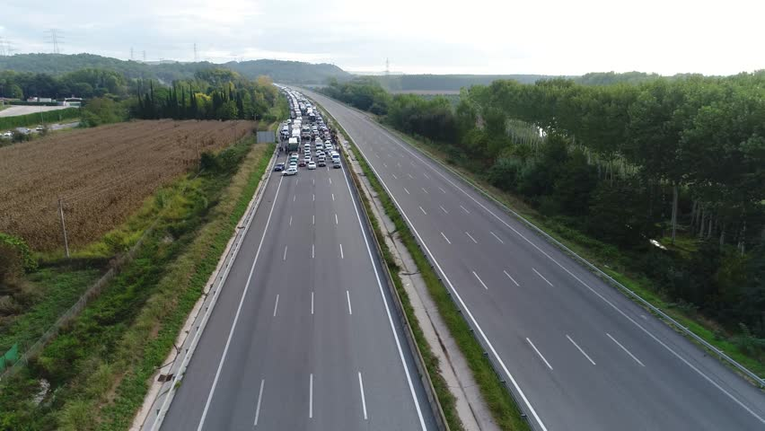 Aerial with European Highway Traffic Jam in One Direction Empty free Lanes in the other Direction | Shutterstock HD Video #31661524