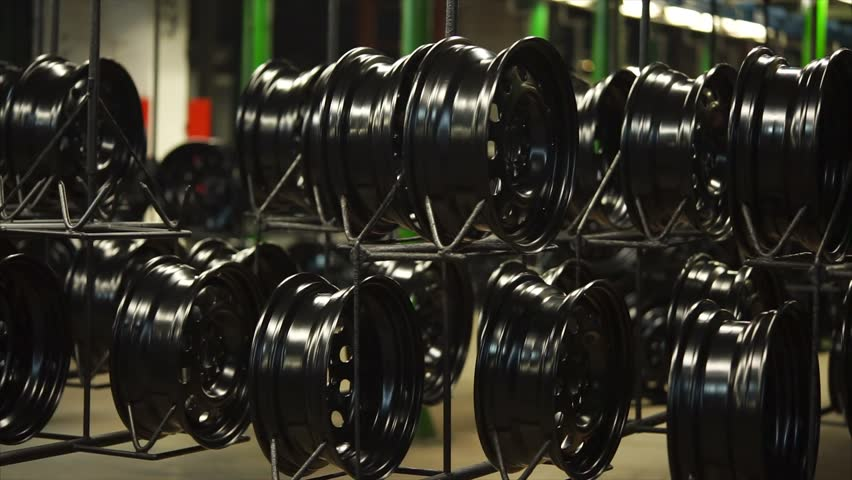 Moving conveyor belt of rims in the factory. Finished products are ready for packing.