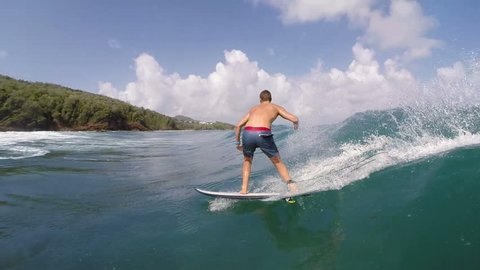 POV Follow Camera Of Young Man Surfing Wave