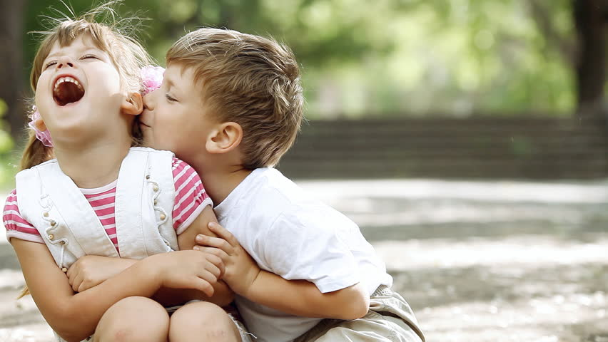 Two children playing in park, outdoors | Shutterstock HD Video #3167341
