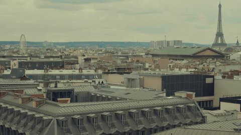Paris roofs and Eiffel Tower. Beautiful roofs view in Paris City downtown with skyline under sunlight at day time.